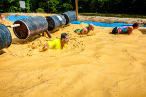 Barrel Roll Obstacle at the Emerald Coast MudRun for Orphans